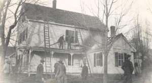 Hudson men battling  an active fire at the Bassett Home on Ferry Street - 1913